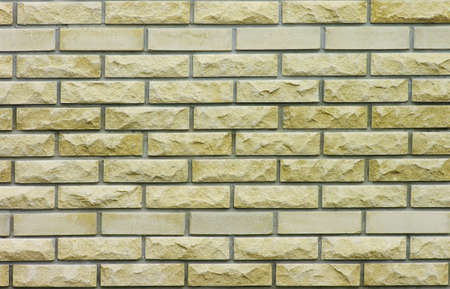 ancient prison: Yellow brcik wall background. Brick texture. Stock Photo