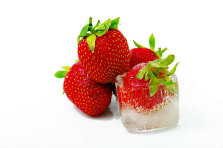 One strawberry into ice. Focus on the ice. photo