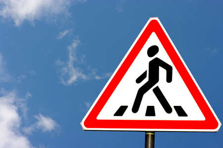 road signs; pedestrian crossing stripes on the blue sky