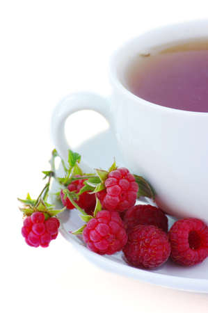 raspberry tea on the white background. Herbal tea.