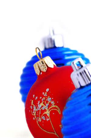 blue christmas balls and one red christmas ball photo