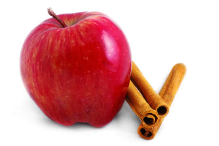 Shiny red apple and cinnamon sticks isolated on a white background.  Stock Photo