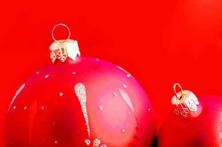 bedeck: red christmas balls on the red background