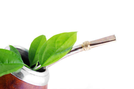 mate: Isolated Leather Mate Cup with Straw and yerba green leafs