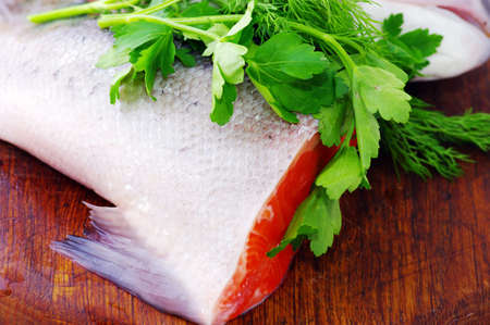Trout tail with parsley on the plat of wood. Stock Photo - 5917810
