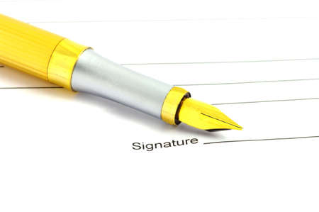 Golden pen on paper.
