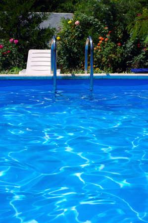 Luxury Resort Pool at the garden. Stock Photo