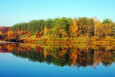 Picturesque autumn landscape on the river  photo