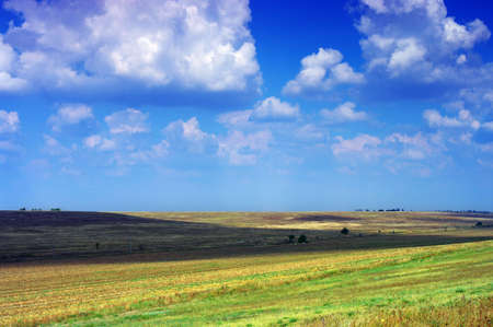 Amazing mountains and fields with blue sky photo