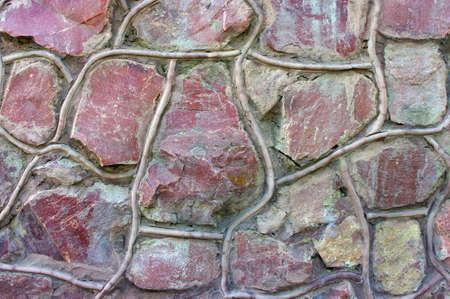 irregular shapes: Traditional Stone Brick Wall made of fragment stones in irregular shapes  Stock Photo