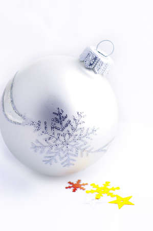 christmas white background, with a christmas balls (selective focus).A white and yellow christmas star and white chrtistmas ball over white background.  Stock Photo - 13924479