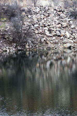 Black water of lake in old quarry  photo
