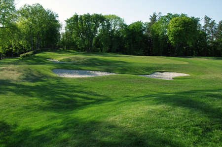 Sand bunkers on the golf course.  photo