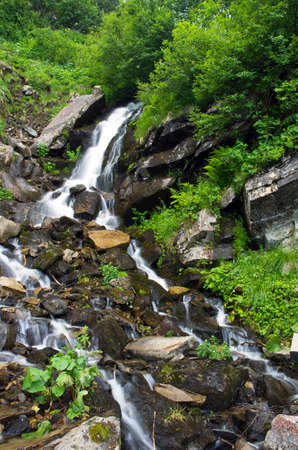 landscape with waterfall in the mountains  photo