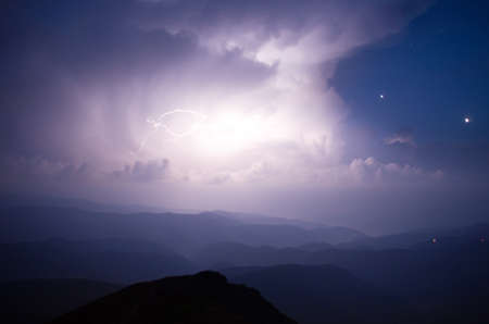 thunderhead: Carpathian Mountains. Mount Pop Ivan. Thunderhead and the starry sky above the ridge Montenegrin Stock Photo