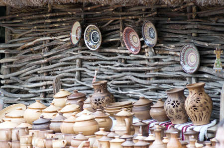 limbo: Products made of red clay. Pottery of different sizes exhibited in the street