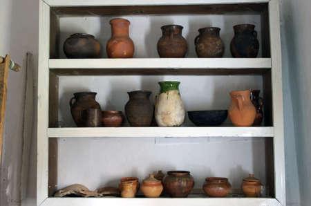 domestic scene: Ancient domestic scene with vintage pottery Stock Photo