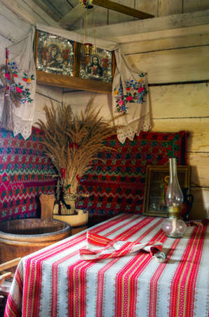 dwelling: Ukrainian historical peasant dwelling interior with various home articles. (museum)