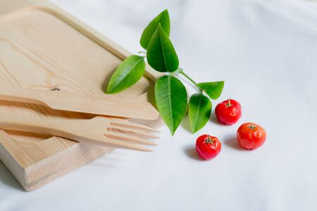 cheery: Wooden kitchenware with cheery and leaf decoration
