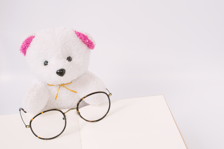 dolly: Dolly bear with glasses on notepad, vintage style
