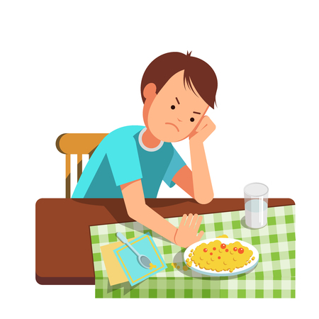does: A little boy refusing food, kid does not want to eat. Kid sits at the table and does not want to eating