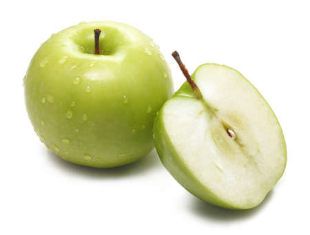 Whole fresh green apple and sliced pieces on white background  Stock Photo