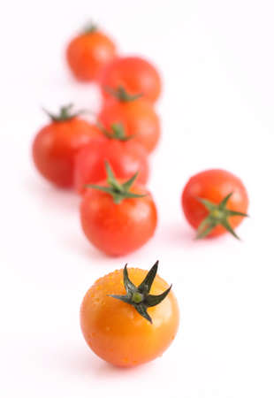 Fresh and juicy red cherry tomatoes on a white background