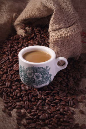 Traditional chinese nanyang style coffee, coffee beans and burlap sack