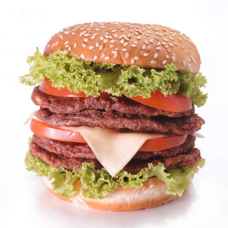 Handmade double meat burger with vegetable and tomatoes on white background
