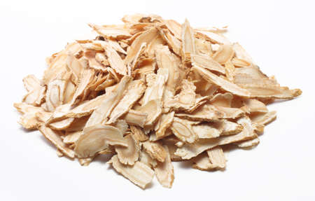 Angelica root slices isolated on a white and plain background Stock Photo