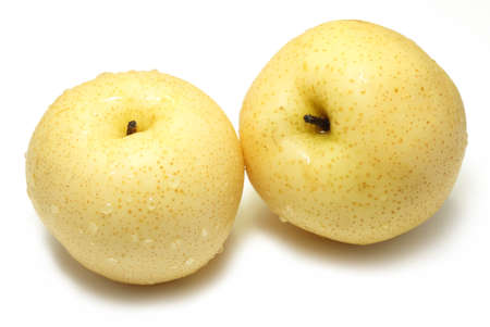 Two fresh and juicy Asian pears on a white background