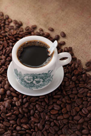 Traditional chinese nanyang style coffee and coffee beans on sack burlap background