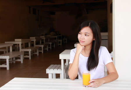 lady drinking orange juice in the morning Stock Photo