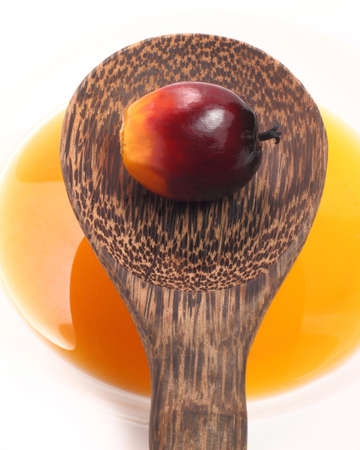 cooking oil: Oil palm fruit, cooking oil and wood ladle on white background