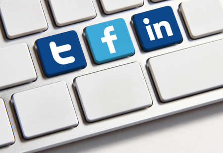 Johor, Malaysia - Sep 25, 2013: Facebook, Twitter and Linkedin icon on keyboard. There are famous website in the world, Sep 25, 2013 in Johor, Malaysia.