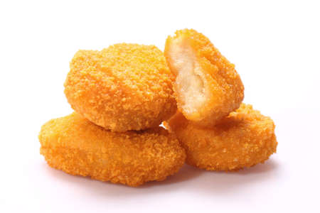 A pile of chicken nuggets isolated on a white background