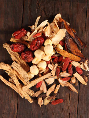 codonopsis roots: Traditional chinese dried herbal medicine on brown color wooden background