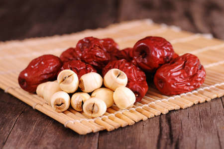 jujube fruits: Dried chinese jujubes fruits and lotus seeds on bamboo mat