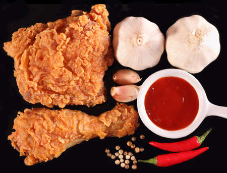 Hot and crispy fried chicken, chili sauce, garlic and black pepper photo