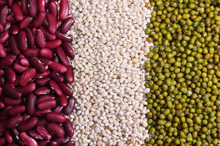 Various colorful beans and grains as background  photo