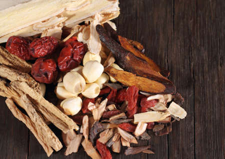 traditional medicine: Traditional chinese dried herbal medicine on brown color wooden background