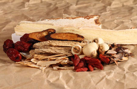 codonopsis roots: Traditional chinese dried herbal medicine on simple brown color background
