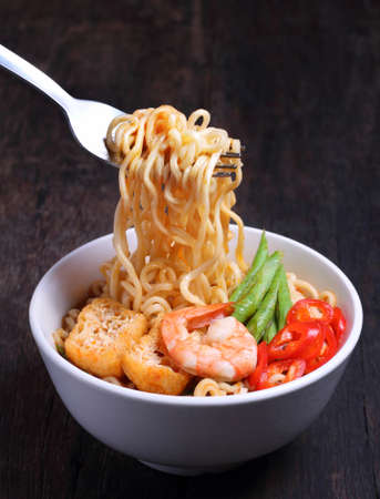 Hot and spicy instant noodle isolated on the dark color background