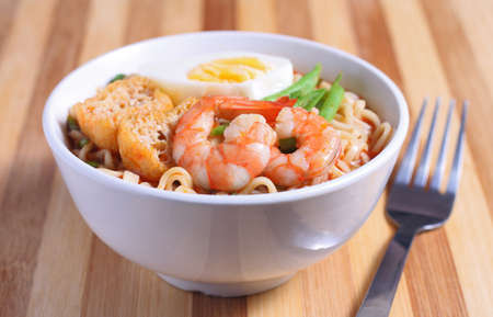 instant noodle: Hot and spicy instant noodle and fork on the table