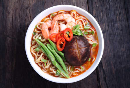 instant noodle: Hot and spicy instant noodle isolated on the dark color
