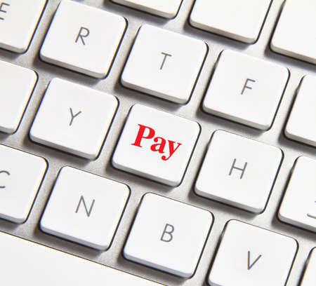 pay money: Photo of pay button on the white keyboard.