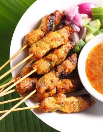 Malaysian chicken satay with delicious peanut sauce, one of famous local dishes
