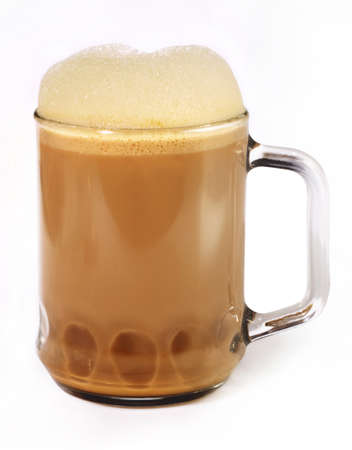 pulled: Teh tarik is comprised of black tea, sugar, and condensed milk mixed to frothy perfection  Stock Photo