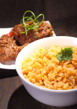 nasi: Nasi Briyani is a wholesome rice-based dish prepared with spices, rice, meat and vegetables. Stock Photo