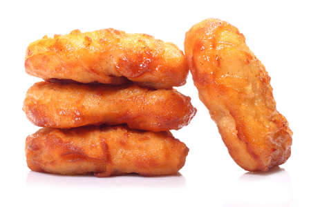 nuggets: Crispy chicken nuggets isolated on white background